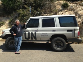 John posing with the UN vehicle