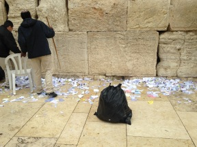 The notes are put into bags and are buried at Har Zeitim (Mt. of Olives) Cemetery