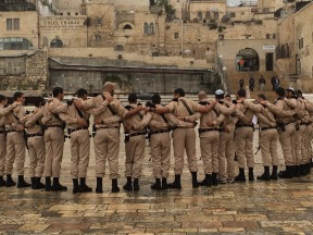 After prayers, the soldiers huddle to do cheers
