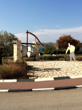 Another kikar (roundabout) sculpture: pioneer with olive press